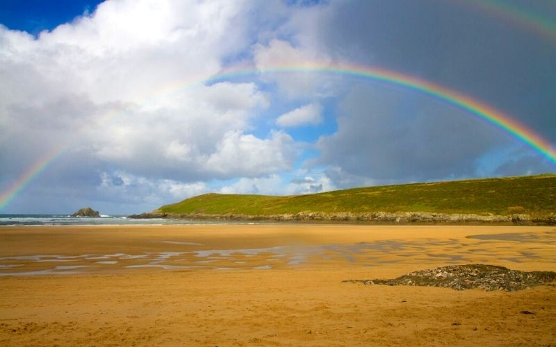 Rainbow over Crantock beach in Cornwall