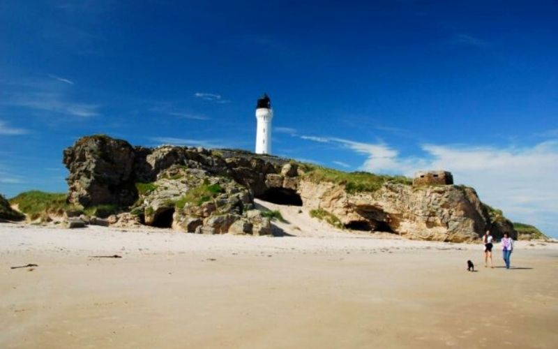 Silver Sands beach in Scotland with Covesea Lighthouse