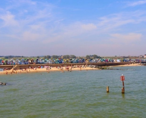 Southwold Beach backed by colourful beach huts.