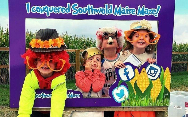 Kids in fancy dress at Southwold Maize Maze near Southwold in Suffolk