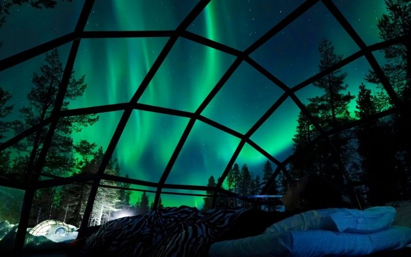 Watching the northern lights from an igloo in Lapland.