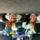 campervanning with kids up in the pop top roof with their cuddly toys.