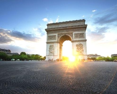 Arc de Triomphe in Paris at sunset.