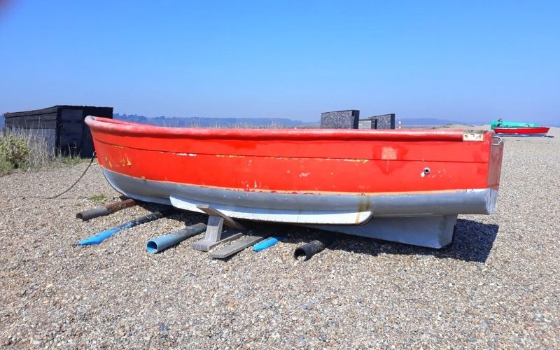 Red fishing boat on Dunwich Beach.