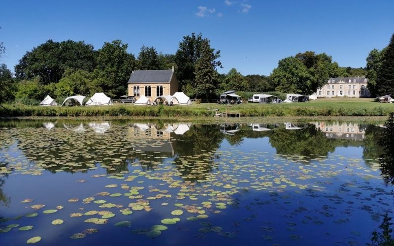 View of Chateau de Chanteloup campsite across a lake.