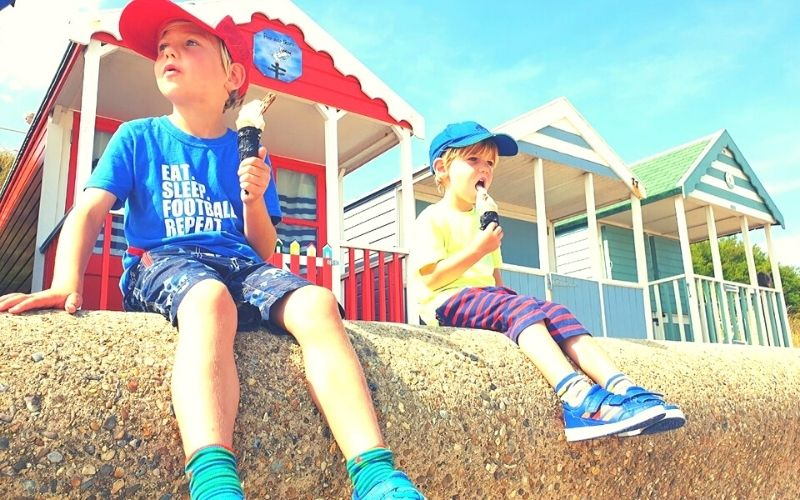 Eating ice creams by Southwold Beach Huts in Southwold.