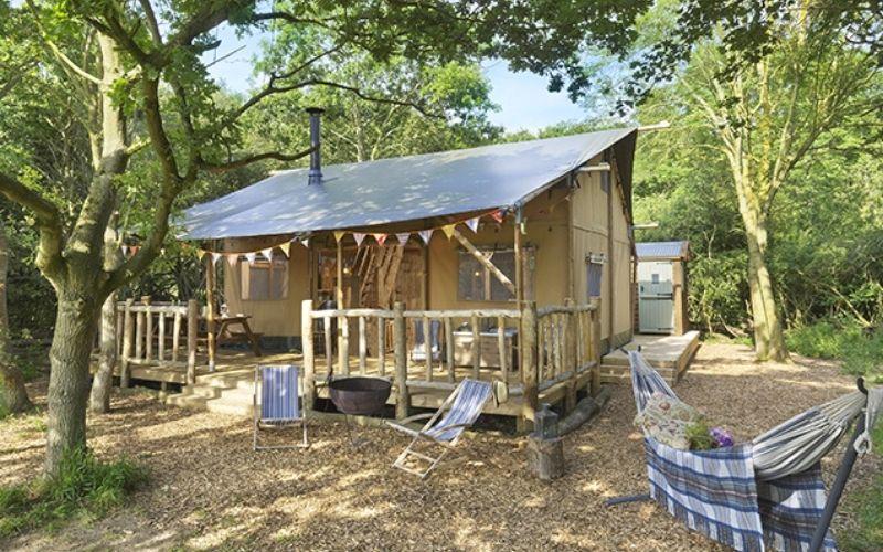 Two storey luxury safari tent at Secret Meadows in Suffolk.