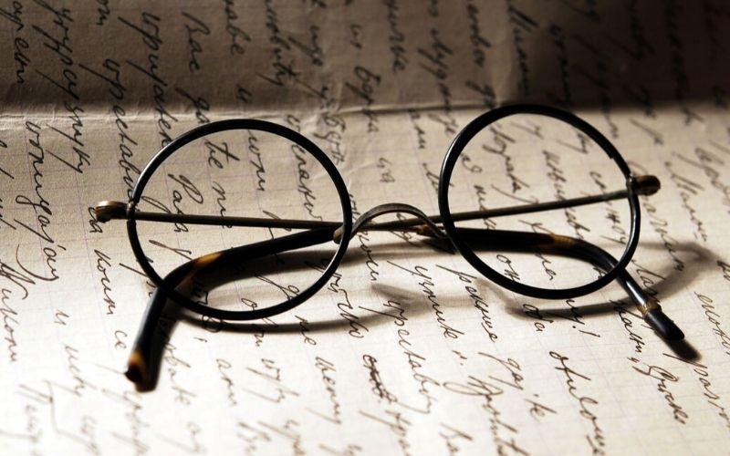 Harry Potter glasses on a manuscript.