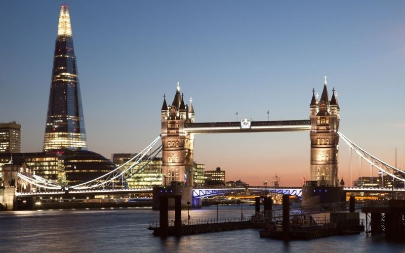 The Shard and Tower Bridge lit up at night.