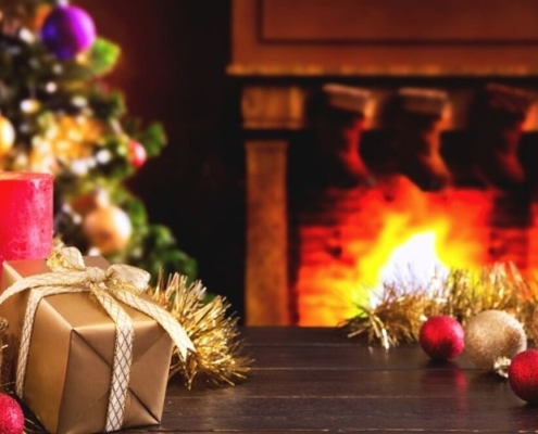 Christmas scene with stockings hanging over fireplace