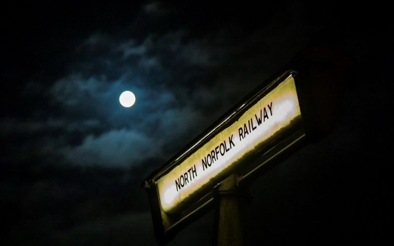 North Norfolk Railway Halloween sign with moon in background.