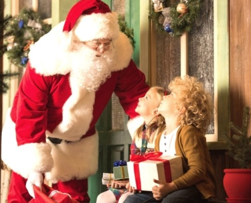 Santa Claus with kids and Christmas presents