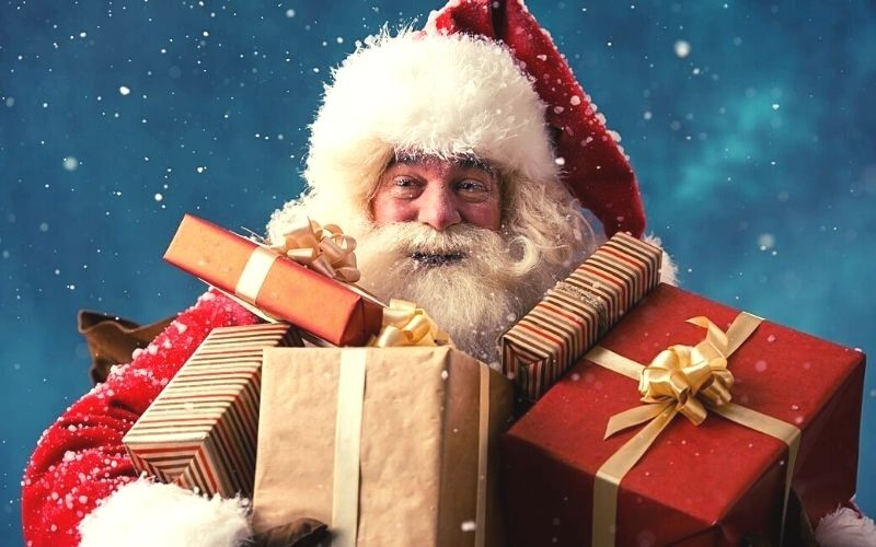Santa carrying presents at Christmas events in Suffolk