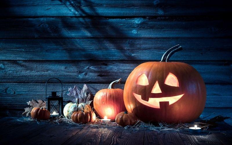Spooky Halloween pumpkins in the dark.