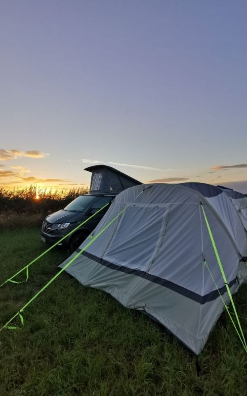VW Campervan with Olpro Cocoon Breeze awning at sunset.