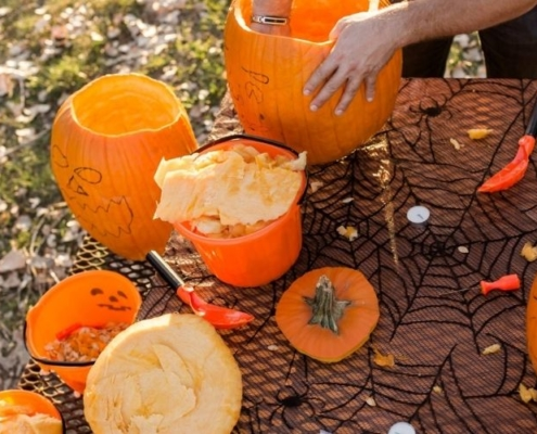 Carving pumpkins while pumpkin picking in Bedfordshire