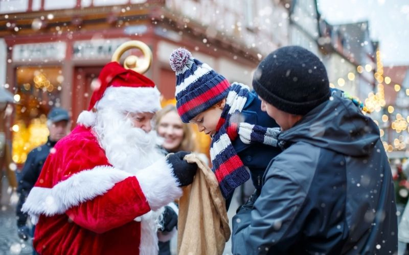 Santa meeting a toddler at one of the Christmas markets in Norfolk